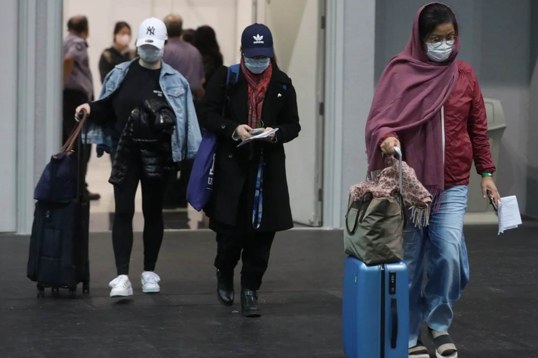People leave after being tested for the coronavirus at Asia-World Expo in Hong Kong. Photo: Winson Wong - SCMP
